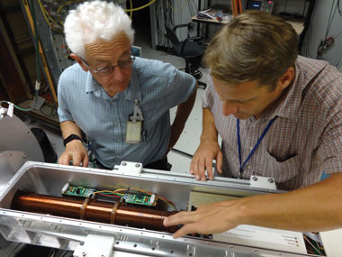 Joe Kilkenny and Terance Hilsabeck, both from General Atomics, inspect the drift tube, a critical component of the single-line-of-sight x-ray diagnostic. The drift tube is analogous to the slow-motion feature on a standard camera.