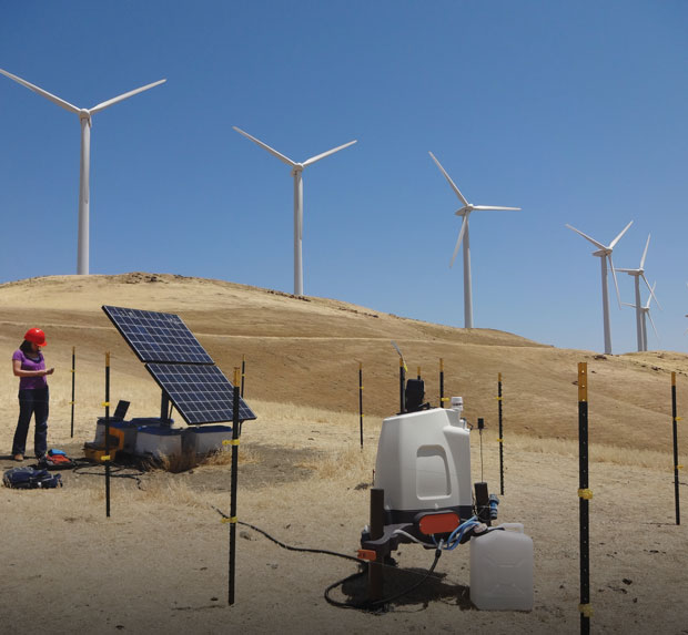 Photo of Jennifer Newman checking on a solar-powered lidar station at a wind farm near Lawrence Livermore.