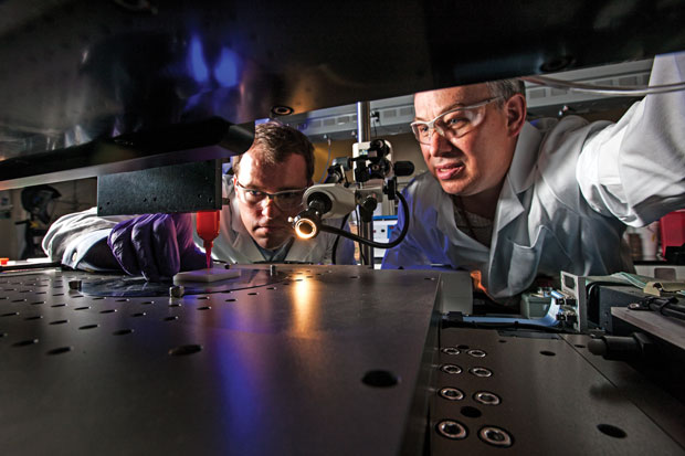 Livermore engineers Eric Duoss (left) and Tom Wilson use an additive manufacturing process called direct ink writing to develop an engineered porous cushion. (Photo by George A. Kitrinos.)
