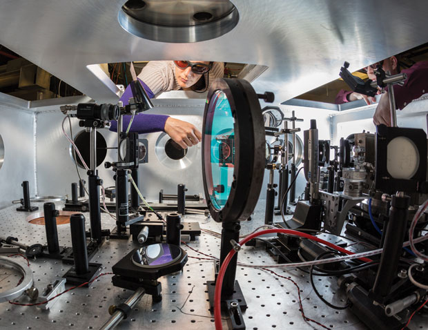 Livermore researchers Félicie Albert (left) and Bradley Pollock prepare the tabletop-sized Callisto laser system for laser-wakefield, high-energy x-ray experiments at the Laboratory's Jupiter Laser Facility.