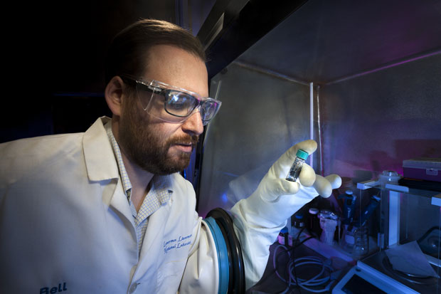 Livermore materials scientist Lars Voss holds a vial containing selenium–iodine. This semiconducting material may be useful for developing long-lasting, reliable radioisotope batteries. (Photo by Randy Wong.)