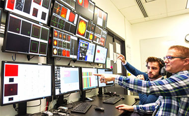 Samuel Buck from ELI Beamlines and Livermore's Shawn Betts monitor HAPLS's system function and performance during operations. HAPLS's high level of automation allows the laser to be run by as few as two people, which meets an operational requirement. (Photo by Jason Laurea.)