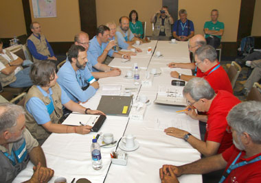 At the end of IFE14, members of the CTBTO inspection team (left, blue shirts) meet with members of the inspected-state party (red shirts) to deliver the preliminary findings.