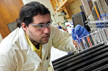 Photo of Livermore nuclear chemist John Despotopulos working with the Laboratory's automated ion chromatography fraction collection system.