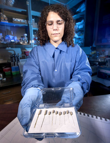 Livermore chemist Anna Marie Belle holds a sample case of chemical biosensors she fabricated for measuring neurotransmitters in the brain. (Photo by Randy Wong.)