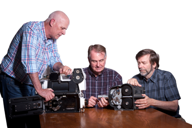 (from left) Jim Moye, Greg Spriggs, and Peter Kuran examine two high-speed, rotating-prism cameras similar to those used for recording mid-20th century atmospheric nuclear tests. The Fastax (left) and Eastman both shoot 16-millimeter film. (Photo by Randy Wong.)