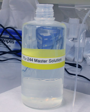 Following several stages of purification, the team prepared a master solution of plutonium-244. Five-milliliter aliquots of the solution were dispensed into 190 (30-milliliter capacity) fluorinated ethylene propylene bottles, which will eventually be sent to IAEA's Network of Analytical Laboratories.