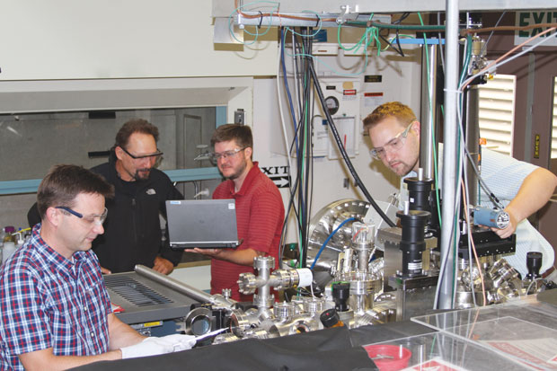 Livermore researchers Jonathan Lee, Juergen Biener, Brandon Wood, and Michael Bagge-Hansen test cell components for ultrahigh vacuum capability in preparation for x-ray spectroscopy measurements of supercapacitor electrode behavior at Lawrence Berkeley's Advanced Light Source.