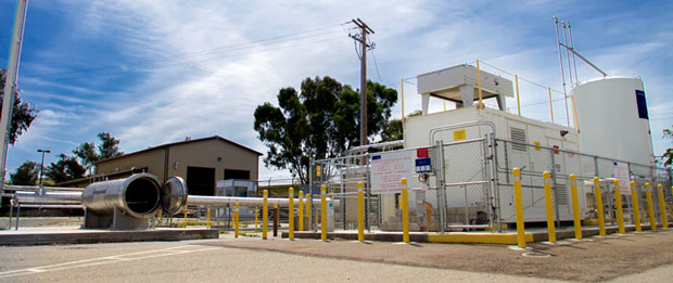The two main components of Lawrence Livermore's Cryogenic Hydrogen Test Facility are (left) the stainless steel containment unit used to test prototype hydrogen storage vessels and (right) the liquid-hydrogen pump built by Munich-based Linde Corporation.