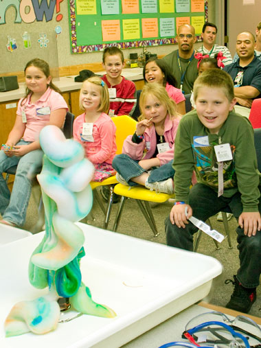 "In an experiment that illustrates basic chemistry concepts, hydrogen peroxide reacts with dish soap and potassium iodide to create ""elephant's toothpaste."""